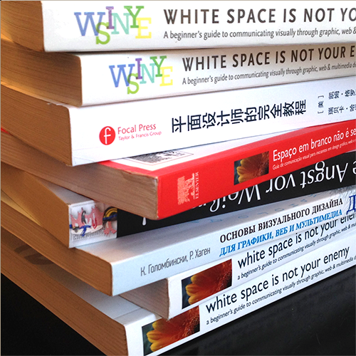 Spines of editions and translations of White Space is Not Your Enemy graphic design textbook